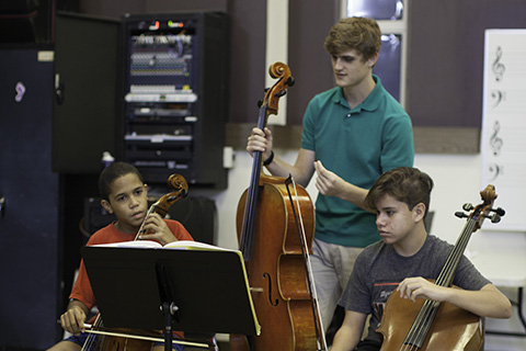 Frost School of Music students working with children
