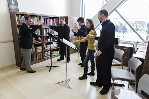 Frost faculty and students practicing together in a studio