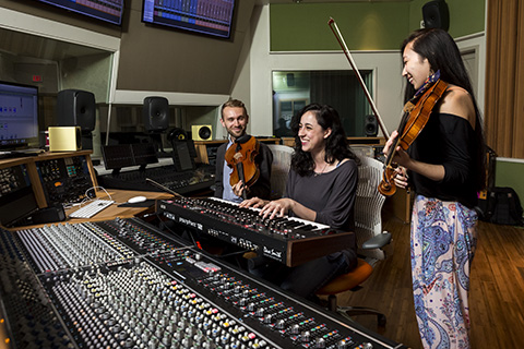 Students practicing in the Weeks Recording Studio