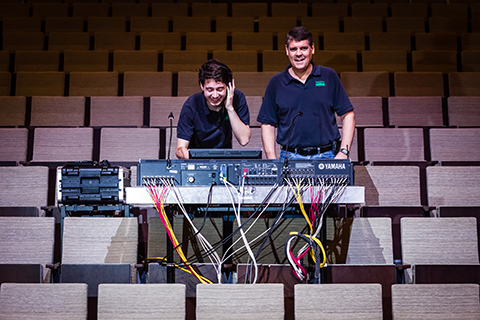 Student working on a soundboard for a concert