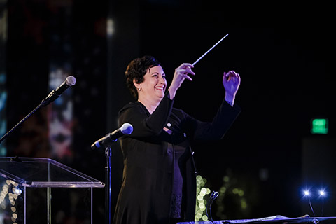 Frost School of Music's faculty member, Karen Kennedy, conducting during a performance